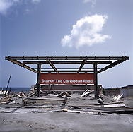 The former capital of Montserrat, Plymouth, which is now covered under a layer of ash, mud and rock from the eruption of the Soufriere Hills volcano over the last 10 years. The area is out of bounds to everyone except scientists. Photo shows Star of The Caribbean petrol station covered in ash and mud..Photo©Steve Forrest/Workers Photos