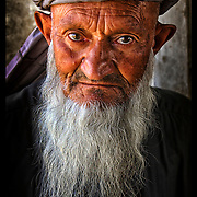An Afghan elder looks on from his home in the Shomali Valley of Afghanistan Aug. 29, 2002.