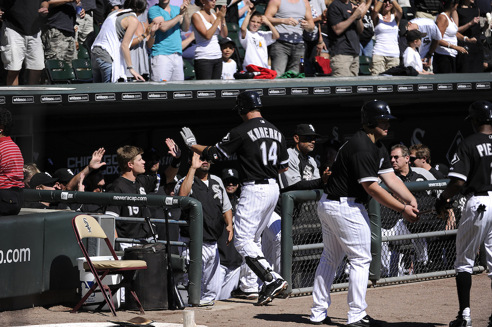 CHICAGO - SEPTEMBER 12:  Paul Konerko #14 of the Chicago White Sox is greeted by teammates after hitting the first of two, two-run home runs in the first inning against the Kansas City Royals on September 12, 2010 at U.S. Cellular Field in Chicago, Illinois.  The White Sox defeated the Royals 12-6.  (Photo by Ron Vesely)