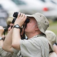 Birdwatchers, Gary Clark, with binoculars, La Selva Biological Reserve, Costa Rica.