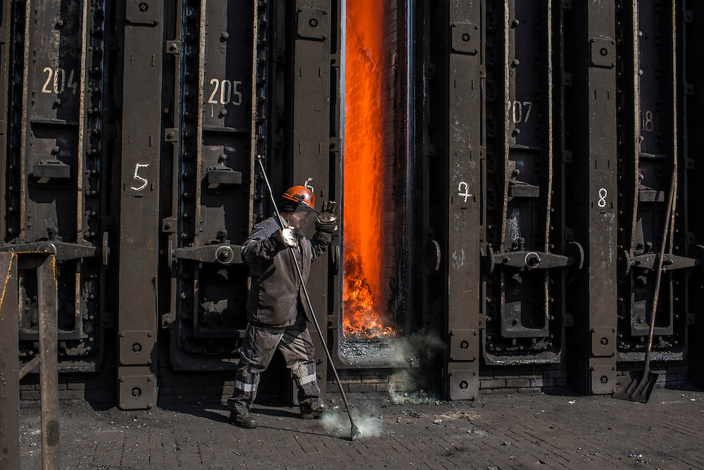 AVDIIVKA, UKRAINE - MARCH 18, 2015: A worker at the Avdiivka Coke and Steel plant tends to the furnace in Avdiivka, Ukraine. CREDIT: Brendan Hoffman for The New York Times