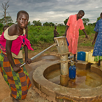 Women in the Sudanese village of Amika draw water from a newly installed well.  Having local water supplies saves hours for families needing water.