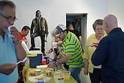 After the formal part of the event, people enjoy something to eat and drink during the more informal part of the annual Cuban Canadian Firendship Association Windsor meeting at Artcite Inc. The event  closes the MayWorks Festival.