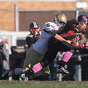 Salesianum defensive end Kyle Cathers (92) sacks William Penn quarterback Daniel Johnson in the fourth quarter during a regular season football game between No. 2 Salesianum and No.1 William Penn Saturday, Oct. 31, 2015 at William Penn High School in New Castle.