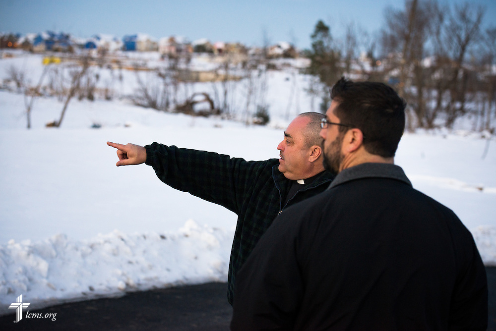 Rev. Thomas Heren of Our Savior Lutheran Church in Washington, Ill., points toward devastated neighborhoods with Rev. Ross E. Johnson, director of LCMS Disaster Response, on Wednesday, Dec. 18, 2013.  Nearly two dozen tornadoes plowed through Illinois in November, killing a total of seven. The damaged LCMS church served as a relief center for members and nearby residents. LCMS Communications/Erik M. Lunsford