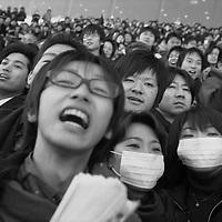 Crowds of Japanese at the horse racing track at Nishi-Funabashi, Tokyo, Japan.