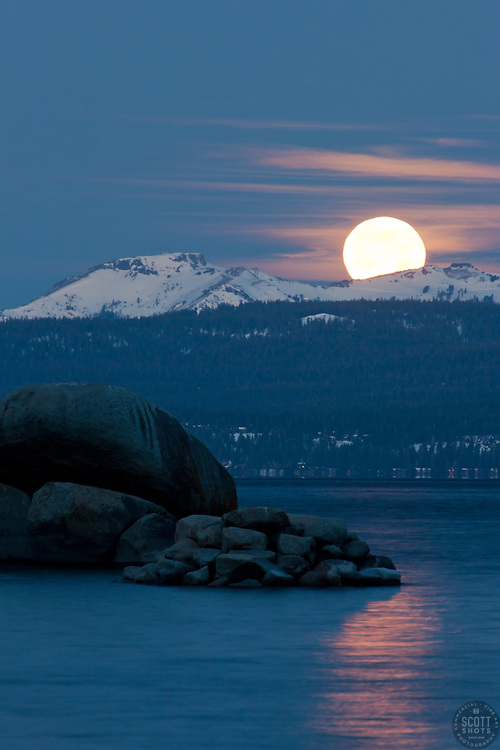 """Full Moon Setting Over Tahoe 1"" - Photograph shot from Sand Harbor of a full moon setting in the early morning over Lake Tahoe, Nevada."