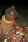 Africa, Kenya, Turkana tribe Mother breast-feeding her baby October 2005