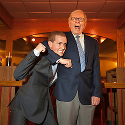 Warren Buffett poses with business students from universities around the country after at lunch at Piccolo Pete's Restaurant in Omaha, Neb., Nov. 11, 2011. Here, Buffett poses with Alex Williams, 21, senior at Gonzaga University.
