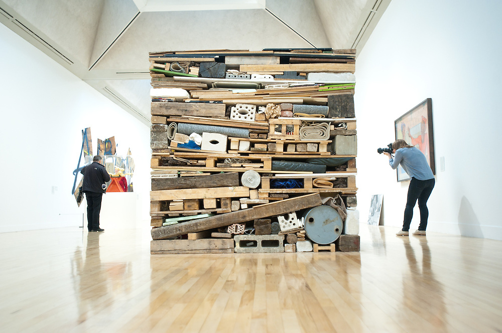 "London, UK - 13 May 2013: A photographer takes a picture next to a work by Tony Cragg entitled ""Stack 1975"". The new chronological presentation of the world's greatest collection of British art will allow visitors to experience the national collection of British art in a continuous chronological display from the 1500s to the present day."
