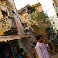 In the streets of the flat complex of Santhome. Santhome Beach and adjoining Marina Beach in Chennai, India were hit hard by the 2004 Tsunami. Fishermen and their families were the main victims living in their lightweight huts on the long and flat beaches of the area. All structures within 300 metres of the sea have now been banned and any left standing after the Tsunami were demolished. The fishermen and their families have now been relocated to government blocks of flats which has become a Santhome slum for fishermen and their families.