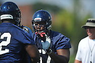 Ole Miss' Terrell Brown works on blocking techniques during football practice in Oxford, Miss. on Sunday, August 7, 2011.