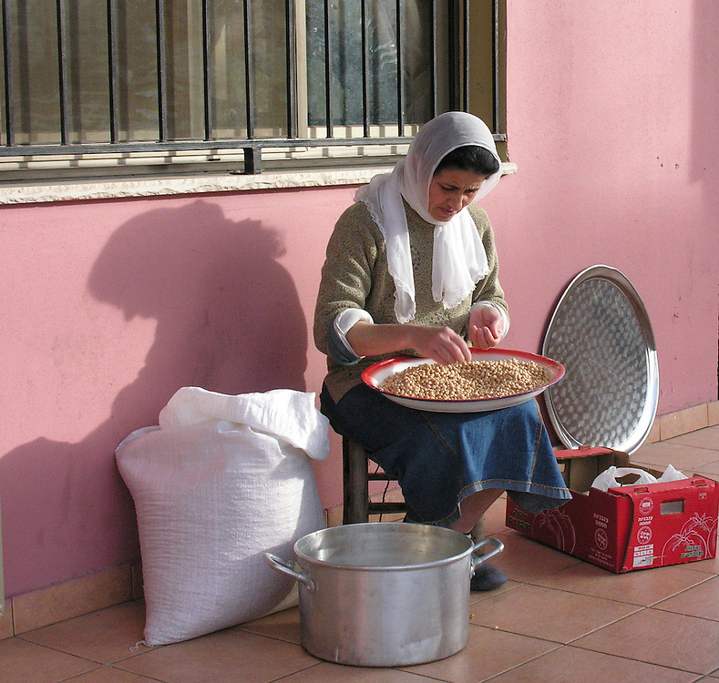 Preparing a humus meal for her restaurant guests. The village of Peki'in is one of the oldest villages in Israel.