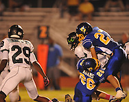 Oxford High's Robert Farris (27) and Oxford High's John Adams (26) make a sack vs. Lake Cormorant in Oxford, Miss. on Friday, October 5, 2012. Oxford High won 26-0.