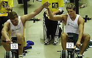 © Peter Spurrier/Sports Photo +44 (0) 7973 819 551.PPP Healthcare British Indoor Rowing Championships.18th Nov. 2001.National Indoor Arena..Matthew Pinsent (L) joins hand with his rowing partner James Craacknell, after he won [Pinsent] the British Indoor Rowing Championships at Birmingham in the final few sscc's of the race... ...........