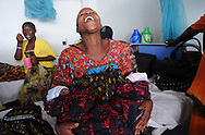 MWANZA, TANZANIA.  A Tanzanian mother laughs with her one-day old twins in the Post Natal Ward at Bugando Medical Center in Mwanza, Tanzania on Thursday, September 4, 2014.  © Chet Gordon for AmeriCares
