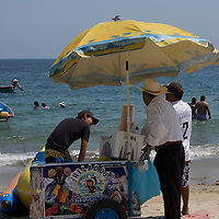 Beach vendor sells ice cream on the beach in Puerto Vallarta -Mexico