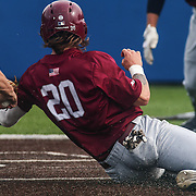 Saint Joseph's Catcher Brian Lau (20) avoids the tag while sliding into home plate during a regular season baseball game between Delaware and Saint Joseph's at Bob Hannah Stadium Tuesday April 19, 2016, in Newark.