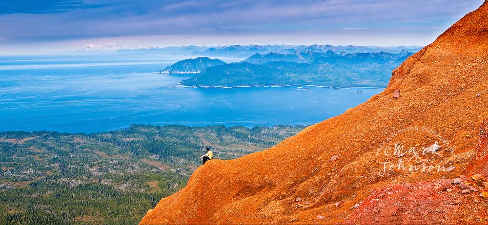 Man admiring the view from the summit of Mt. Edgecumbe, Kruzof Island, Southeast Alaska