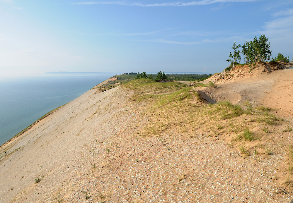 The sun sets on Sleeping Bear Bluffs, which rise as high as 450 feet above Lake Michigan.<br /> <br /> Sleeping Bear Dunes National Lakeshore, Michigan