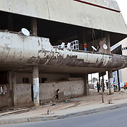 26 September 2011, Lubango, Angola. General street scenes of life in the Provincial capital. This group of people only appeared at night time in the damaged building.