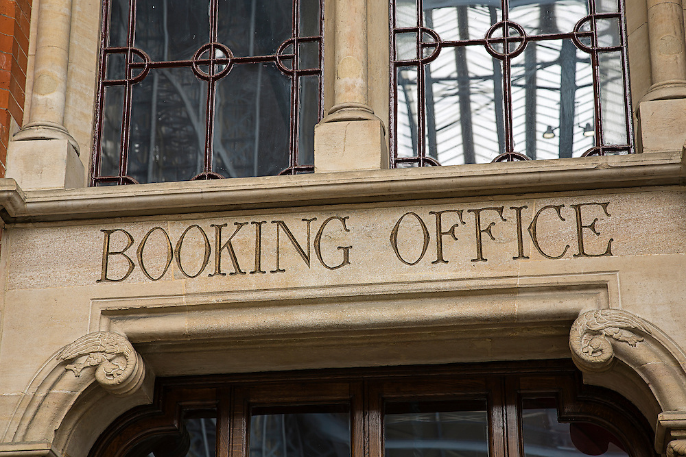A booking office sign in an old Victorian building