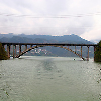 Asia, China, Yangtze River. Scene of the Dragon Gate Bridge depicting the rising water levels of the Yangtze River.