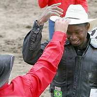 Gustavo Silva is congratulated after winning the Barretos na America rodeo at the Brockton Fairgrounds, Sunday,  May 24, 2009.
