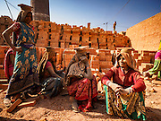 03 MARCH 2017 - BAGMATI, NEPAL: Women who work at a brick factory in Bagmati, near Bhaktapur, takes a break in the kiln at the factory. There are almost 50 brick factories in the valley near Bagmati. The brick makers are very busy making bricks for the reconstruction of Kathmandu, Bhaktapur and other cities in the Kathmandu valley that were badly damaged by the 2015 Nepal Earthquake. The brick factories have been in the Bagmati area for centuries because the local clay is a popular raw material for the bricks. Most of the workers in the brick factories are migrant workers from southern Nepal.       PHOTO BY JACK KURTZ
