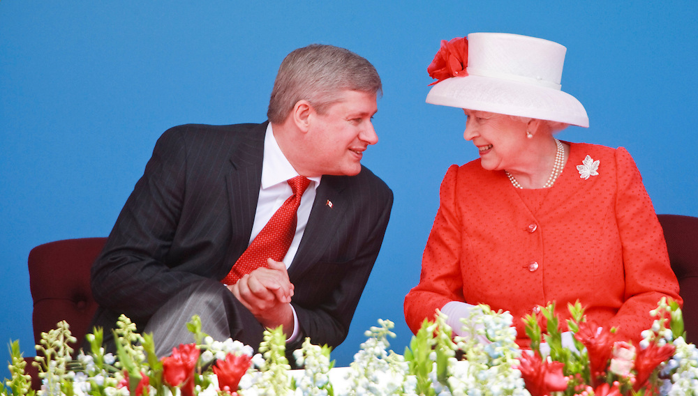 Queen Elizabeth II talks with Canadian Prime Minister Stephen Harper during Canada Day celebrations on Parliament Hill in Ottawa, Ontario, July 1, 2010. The Queen is on a 9 day visit to Canada. <br /> AFP/GEOFF ROBINS/STR