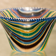"""Ribbon glass cup from 25 BC to AD 50. The fascinating Corning Museum of Glass (CMOG.org) covers the art, history and science of glass, brought to life through live glassmaking demonstrations, offered all day, every day, in Corning, New York, USA. The not-for-profit museum was founded in 1951 by Corning Glass Works (now Corning Incorporated) and has a collection of more than 45,000 glass objects, some over 3500 years old, the """"world's best collection of art and historical glass."""""""