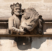 King and Lion Gargoyle below Magdalen Great Tower, part of Magdalen College, Oxford University, England.