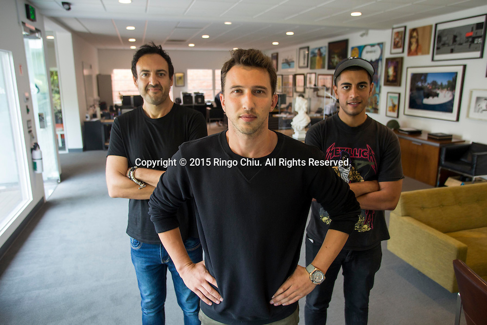Brandon Korff, center, grandson of tycoon Sumner Redstone, with his business partners Paolo Fidanza, left, and Q Ladraa, right.(Photo by Ringo Chiu/PHOTOFORMULA.com)