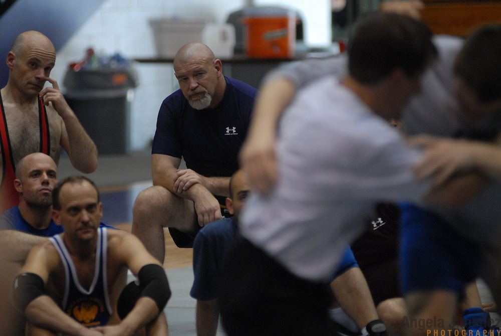 Gay and lesbian wrestlers participate in a wrestling clinic taught by Northwestern University's head men's wrestling coach Tim Cysewski (seen in foreground doing a demonstration) at McGaw Memorial Hall/Welsh-Ryan Arena in Evanston, Illinois during the Gay Games VII competition on July 16, 2006.<br /> <br /> Over 12,000 gay and lesbian athletes from 60 countries are in Chicago competing in 30 sports during the Games from July 15 through 22, 2006. <br /> <br /> Over 50,000 athletes have competed in the quadrennial Games since they were founded by Dr. Tom Wadell, a 1968 Olympic decathlete, and a group of friends in San Francisco in 1982, with the goal of using athletics to promote community building and social change. <br /> <br /> The Gay Games resemble the Olympics in structure, but the spirit is one of inclusion, rather than exclusivity. There are no qualifying events or minimum or maximum requirements.<br /> <br /> The Games have been held in Vancouver (1990), New York (1994), Amsterdam (1998), and Sydney (2002).