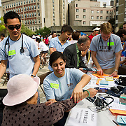 Health Sciences students representing Tufts participate in the Annual Chinatown Oak Street Fair. (Alonso Nichols/Tufts University)