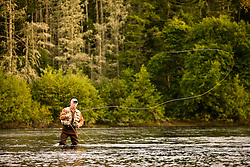 A man fly-fishing in the Androscoggin River at Mollidgewock State Park in Errol, New Hampshire.