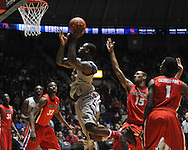 "Ole Miss' Murphy Holloway (31) is fouled by Georgia's Donte' Williams (15) at the C.M. ""Tad"" Smith Coliseum on Saturday, February 16, 2013. Mississippi won 84-74 in overtime. (AP Photo/Oxford Eagle, Bruce Newman)"
