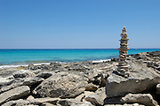 Stone sculpture on Llevant beach, Formentera, Balearic Islands, Spain