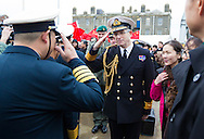 Rear Admiral Clive Johnstone salutes officers stand from the Chinese Naval assault ship Chang Bai Shan at Portsmouth Royal Navy Base today. The ship is involved in the first visit by the Chinese Navy to the UK since 2007 and the largest ever. She is accompanied by the frigate Yun Cheng and the replenishment ship Chaohu. The ships arrived in Portsmouth 24 hours early due to the expected bad weather. The Royal Navy statement stated that the five day formal visit is aimed at enhancing military understanding between the UK and China. Picture date Monday 12th January, 2015.<br /> Picture by Christopher Ison. Contact +447544 044177 chris@christopherison.com