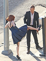 "Los Angeles, CA. December 13th 2010  Non Exclusive. Justin Timberlake returns to work filming his movie ""NOW"" after the production shut down due to an ankle injury Timberlake suffered on set last week. Actress Amanda Seyfried was also on set with Justin and the pair appeared to have geat chemistry together on and off camera. After a scene with a gun was finished Amanda jokingingly took the gun from Justin and pointed it at his crotch. Justin seemed bothered by his injury at one point when he was seen removing  his shoe and sock to re wrap support on his ankle. Photo by Eric Ford 818-613-3955 onlocationnews@att.net"