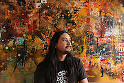 Tijuana Mexico ..San Diego based artist Gerardo Yepiz, founder of Acamonchi, at his studio ..While working on this long term project 'La Frontera' I want to examine the cultural and humanitarian activities on both sides of a border that keeps the United States and Mexico apart with a wall of steel already 600 miles long. The turf wars of drug cartels, arms trafficking and rampant kidnappings turned cities like Tijuana into some of the most dangerous places on earth. Despite the violence many brave artists, photographers, architects, poets, humanitarians, teachers etc live and work in the shadow of the wall on both sides and have a positive influence on this region; they are the focus of my long term project along the border. (Over time I plan to cover the entire length from the Atlantic to the Pacific, these images were taken in and around Tijuana).© Stefan Falke