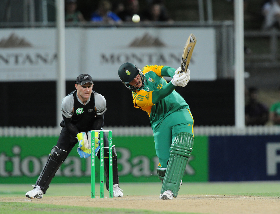 South Africa's Richard Levi clubs the ball to the boundary in front of the New Zealand keeper Brendon McCullum in the second twenty/20 International Cricket match, Seddon Park, Hamilton, New Zealand, Sunday, February 19, 2012. Credit:SNPA / Ross Setford