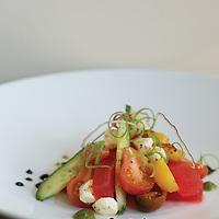 Heirloom Tomatoes+Cucumbers+Fresh Mozzerella Pearls+Watermelon+extra Virgin Olive Oil.(Jodi Miller/Monthly)