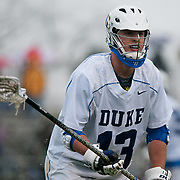 Duke defender Chris Hipps #13 guards out of bounds play. The third-ranked Fighting Irish defeated sixth-ranked Duke, 13-5, in men's lacrosse action on a snowy Saturday afternoon at Koskinen Stadium in Durham, N.C.