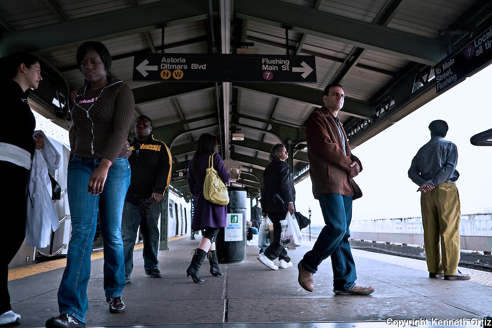 New York Straphangers waiting for a train on Queens Borough Plaza station in Long Island City Queens.