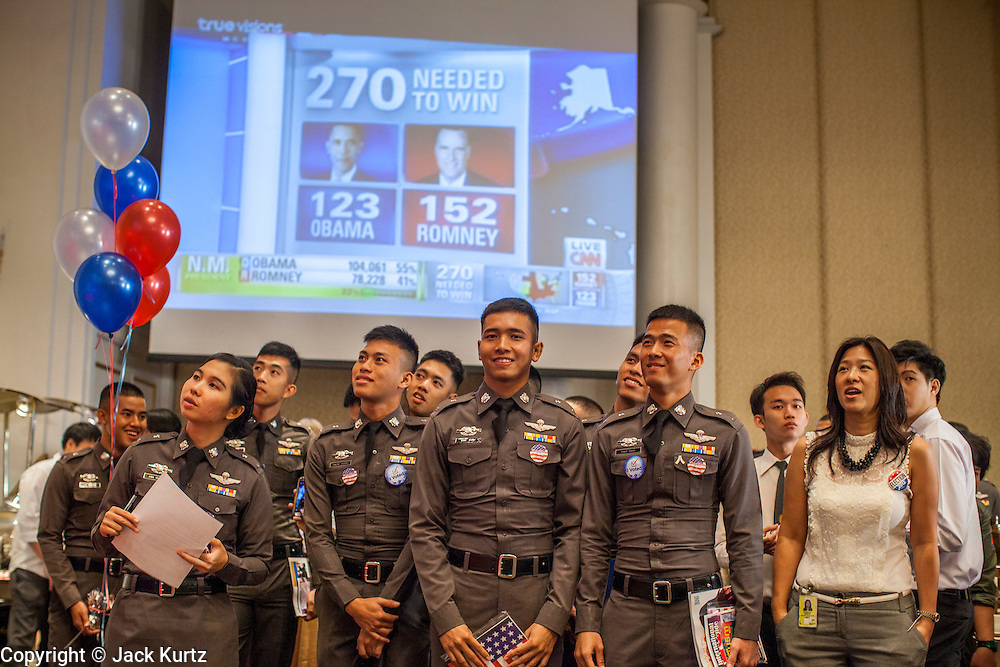 07 NOVEMBER 2012 - BANGKOK, THAILAND:  Thai police cadets watch election returns roll in at the US Embassy's election watch party in Bangkok. US President Barack Obama won a second term Tuesday when he defeated Republican Mitt Romney. Preliminary tallies gave the President more than 300 electoral votes, well over the 270 needed to win. The election in the United States was closely watched in Thailand, which historically has very close ties with the United States. The American Embassy in Bangkok sponsored an election watching event which drew thousands to a downtown Bangkok hotel. American Democrats in Bangkok had their own election watch party at a restaurant in Bangkok.      PHOTO BY JACK KURTZ