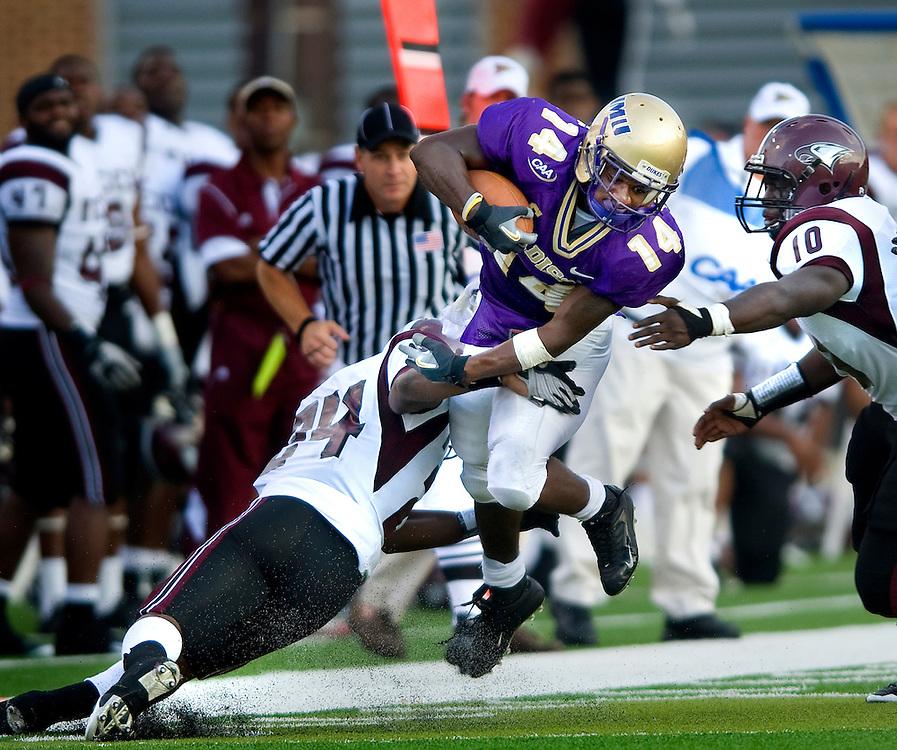 JMU tailback Eugene Holloman breaks a tackle in the second quarter against North Carolina Central University Saturday.