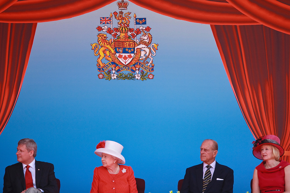 Queen Elizabeth II and Prince Philip, The Duke of Edinburgh, Prime Minister Stephen Harper and his wife Laureen Harper watch the entertainment during Canada Day celebrations on Parliament Hill in Ottawa, Ontario, July 1, 2010. The Queen is on a 9 day visit to Canada.