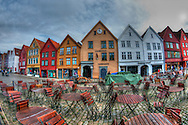 colored wooden tree houses old city Bergen cafe tables