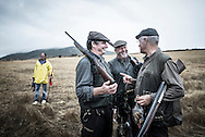 Fernando Melo Gomes, Jacinto Amaro and Constantino Reis in conversation at the end of a day of hunting.<br /> &quot;The Pose and the Prey&quot;<br /> <br /> Hunting in my imagination was always more like taxidermy &mdash; as if the prey was just a mere accessory of the hunter's pose for his heroic photograph &mdash; the real trophy.<br /> <br /> When I decided to document the daily lives of Portuguese hunters, I had in my memory the &quot;clich&eacute;&quot; from the photographer Jos&eacute; Augusto da Cunha Moraes, captured during a hippopotamus hunt in the River Zaire, Angola, and published in 1882 in the album Africa Occidental. The white hunter posed at the center of the photograph, with his rifle, surrounded by the local tribe.<br /> <br /> It was with this clich&eacute; in mind that I went to Alentejo, south of Portugal, in search of the contemporary hunters. For several months I saw deer, wild boar, foxes. I photographed popular hunting and private hunting estates, wealthy and middle class hunters, meat hunters and trophy hunters. I photographed those who live from hunting and those who see it as a hobby for a few weekends during the year. I followed the different times and moments of a hunt, in between the prey and the pose, wine and blood, the crack of gunfire and the murmur of the fields .<br /> <br /> I was lucky, I heard lots of hunting stories. I found an essentially old male population, where young people are a minority. Hunters, a threatened species by aging and loss of economic power caused by the crisis in the South of Europe.<br /> <br /> The result of this project is this series of contemporary images, distant from the &quot;cliche&quot; of 1882.<br /> <br /> &mdash; Antonio Pedrosa